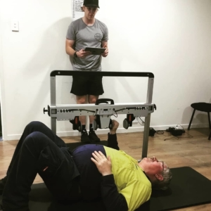 Fighting Fit Physiotherapy employee using VALD ForceFrame on physiotherapy client for better client engagement
